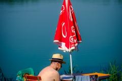UnclePete / Mann mit Hut morgens um  3 vor 10 m See